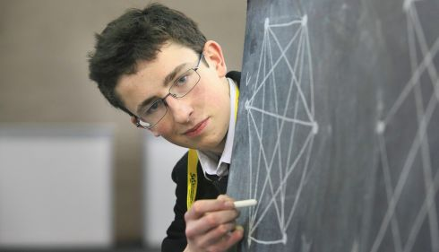 Paul Clarke (17), St Paul's College, Dublin, with his exhibit, Contributions to Cyclic Graph Theory, preparing for the exhibition. Photograph: Gareth Chaney/Collins