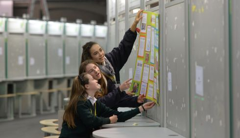 Christine O'Dea, Alanna O'Brien and Zoe May Ralph feom Santa Sabine Dominican College, Sutton, setting up their project.  Photograph: Alan Betson/The Irish Times