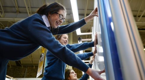 Claire Caulfield, Sita Cogan and Lara Moehle, Dominican College, Drumcondra, put the final touches to their display entitled Marketing Madness - Is Marketing Effective? Photograph: Alan Betson/The Irish Times