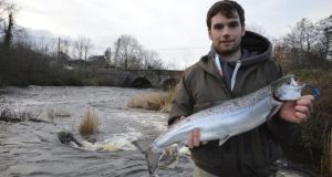 Eoin McManus from Ballyshannon with the first salmon of 2014, caught on the River Drowes in Co Leitrim, last Tuesday. The fish weighed 3.6kg (8lb) and fell to a size-7 brown Rapala lure