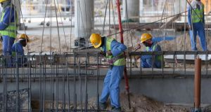 Migrant labourers work on a construction site  in Doha in Qatar.