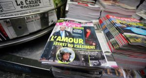 Copies of French magazine Closer, with photos of French president François Hollande and French actor Julie Gayet on its cover, at a newspaper stall on the Champs-Élysées in Paris yesterday. Photograph: AP Photo/Remy de la Mauviniere