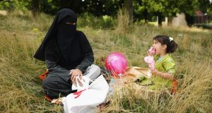 A Muslim woman and girl sit in Burgess Park in London. Self-declared Muslims living in England and Wales   made up 4.8 per cent of the population in 2011, up from 3 per cent in 2001. Photograph: Dan Kitwood/Getty Images