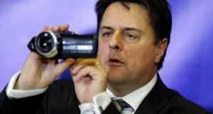 British National Party leader Nick Griffin uses a video camera during a news conference in Athens yesterday. Photograph: AP Photo/Thanassis Stavrakis