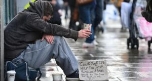 A homeless  man  begs  on  a  Dublin city street. Dublin City Council's budget  proposes that   unding for homeless services will be cut by €6 million. Photograph: Alan Betson/The Irish Times