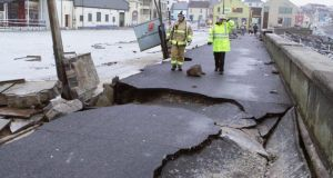 On  the Clare coast  waves tore pavements apart and hammered the Lahinch promenade. Photograph: Press 22