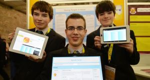 Lochlann O'Reagan, Eryk Zaplata and Paul Rushe from St Aloysius College, Westmeath, with their project on text to speech systems. Photograph: Alan Betson