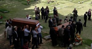 Relatives carry the coffin of  Monica Spear and that of her ex-husband Thomas Henry Berry  during their funeral in Caracas. Photorgraph: Carlos Garcia Rawlins/Reuters