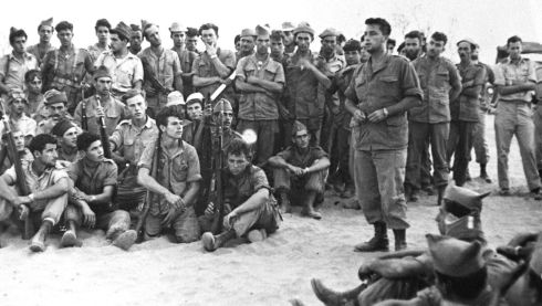 Ariel Sharon (right) briefs his army unit before an operation in  August 1955.   Ariel Sharon, the former Israeli general and prime minister who was in a coma for eight years after he had a stroke at the height of his power, died on Saturday aged 85. Photograph:  Reuters/Israel's Defence Ministry/Handout/Files