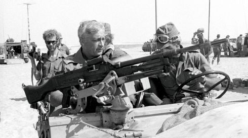 Gen Sharon (front left) rides in a jeep in this October 1973 file photo. Photograph: Reuters/Israel's Defence Ministry/Handout/Files