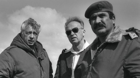 Major Gen Ariel Sharon (left) stands with Israeli prime minister Yitzhak Rabin (centre) and Major General Adam Yekutiel in the Sinai Peninsula in February 1976. Photograph:  Reuters/Moshe Milner/Government Press Office/Handout/Files