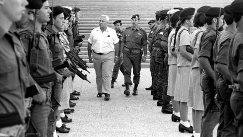Israel's defence minister Ariel Sharon (left) inspects an honour guard during a visit to the central command military base in  October 1981. Photograph:  Reuters/Israeli Defence Ministry/Handout/Files