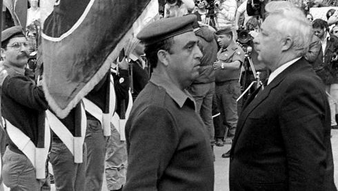 "Outgoing Israeli defence minister Ariel Sharon (right) stands at attention in front of an honour guard during a farewell ceremony on his behalf in Tel Aviv in this handout file picture taken in October 1983. Sharon was forced to resign as defence chief after an Israeli probe said he bore ""personal responsibility"" for not preventing the massacre of hundreds of Palestinian civilians in the Lebanese refugee camps of Sabra and Shatila by Israeli-allied Christian militiamen.  Photograph: Reuters/Gil Goldstein/GPO/Handout/Files"