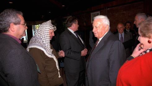 Ariel Sharon (4th left) walks past Palestinian Leader Yasser Arafat (2nd left) during the Middle East peace summit at the Wye River Conference centre October 1998. Photograph: Avi Ohayon/GPO/Handout/Reuters