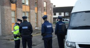 Gardaí outside the apartment block where a body was found in Finglas, Dublin. Photograph: Dara Mac Dónaill/The Irish Times