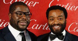 British film director Steve McQueen (left)  with the star of his film 12 Years A Slave Chiwetel Ejiofor. Photograph: Reuters