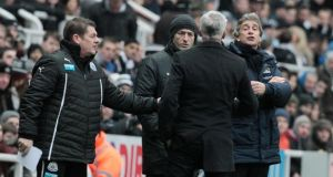 Newcastle manager Alan Pardew (c) argues with his Manchester City counterpart Manuel Pellegrini (r) at St James's Park. Photograph: Lindsey Parnaby/EPA