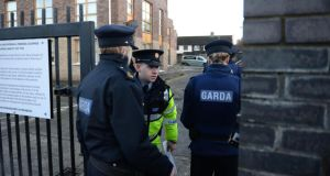 Gardaí at the apartment block where a body was found at Wellmount Road, Finglas, Dublin, on Saturday. Photograph: Dara Mac Dónaill/The Irish Times