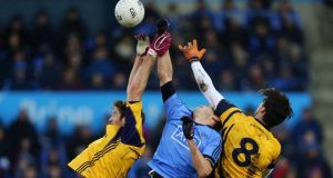 Dublin's Declan O'Mahony battles with Brian Donnelly and Eoin O'Connor of DCU. Photo: Donall Farmer/Inpho /Donall Farmer