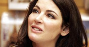 Nigella Lawson: when she gets tired of teaching the world how to make maple buttercream cup cakes she could teach puffed up MBAs how to deal gracefully with humiliation. Photograph: Dara Mac Dónaill