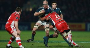 Munster's Paul O'Connell is tackled by Gloucester's Sione Kalamafoni during the Heineken Cup, Pool Six match at Kingsholm Stadium, Gloucester, on Saturday.