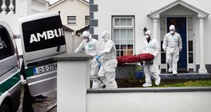 The body of a man is taken from a house in Beechpark Avenue, Castleknock, Dublin on Sunday. Photograph: Dara Mac Dónaill/The Irish Times