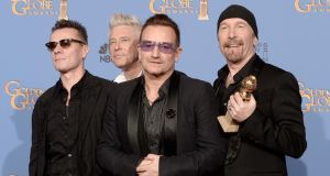 U2's Larry Mullen, Adam Clayton, Bono and The Edge, winners of Best Original Song for Ordinary Love from Mandela: Long Walk to Freedom, at the 71st Annual Golden Globe Awards held at The Beverly Hilton Hotel in California. Photograph: Kevin Winter/Getty Images