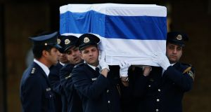 Members of the Knesset guard carry the flag draped coffin of former Israeli prime minister Ariel Sharon before a memorial ceremony today. Photograph: Ronen Zvulun/Reuters