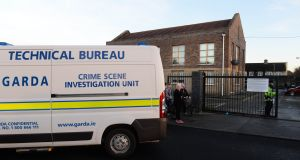 Gardaí at the apartment block where Mr Maher's body was found at Wellmount Road, Finglas, Dublin on Saturday. Photograph: Dara Mac Dónaill/The Irish Times