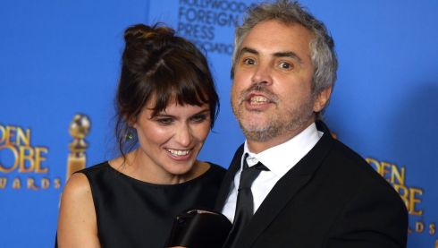 Mexican director Alfonso Cuaron (R) who won the Golden Globe for Best Director - Motion Picture for 'Gravity' as he poses with British writer Sheherazade Goldsmith at the awards ceremony in California last night. Photograph: Paul Buck/EPA