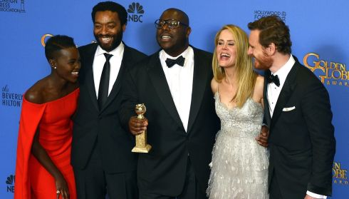 British director Steve McQueen (C) holds the Golden Globe for Best Motion Picture - Drama for '12 Years a Slave' as he poses with (L-R) Kenyan-Mexican actress Lupita Nyong'o, British actor Chiwetel Ejiofor, US actress Sarah Paulson and Michael Fassbender at the Golden Globe awards in California last night. Photograph: Paul Buck/EPA