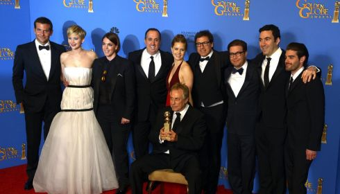 The cast and crew of 'American Hustle' pose with the Golden Globe for Best Motion Picture - Comedy or Musical at the Golden Globes in California last night.