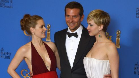 US actors Amy Adams (L), Bradley Cooper (C) and Jennifer Lawrence (R) pictured at the Golden Globes in California last night. Photograph: Paul Buck/EPA
