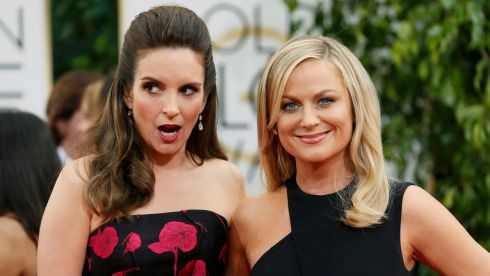 Golden Globes hosts Tina Fey and Amy Poehler pose at the awards in California last night. Photograph: Reuters