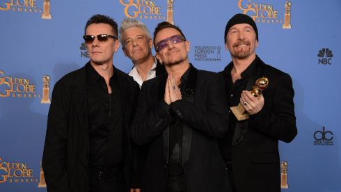 Larry Mullen Jr, Adam Clayton, Bono and The Edge of U2 pose in the press room with the award for best original song for Ordinary Love from the film Mandela: Long Walk to Freedom at the Golden Globes in California last night.