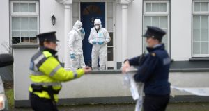 Gardai at the scene at Beech Park Avenue, Castleknock in north Dublin where Tom O'Gorman was found dead yesterday morning. Photograph: Dara Mac Dónaill/The Irish Times
