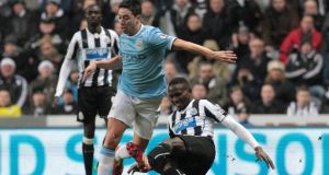 Newcastle's Mapou Yanga-Mbiwa tackles Manchester City's Samir Nasri, resulting in Nasri being taken off on a stretcher and Mbiwa receiving a yellow card, during the Premier League match at Saint James' Park. Photograph: Lindsey Parnaby/EPA