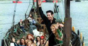 Joanne Doyle and Breandán de Gallaí, lead dancers with Riverdance and other members of the cast onboard a Viking longboat on the river Liffey. Photograph: Bryan O'Brien