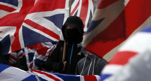 Loyalist protesters demonstrate against restrictions on flying the  union flag from Belfast City Hall in central Belfast last January. Photograph: Reuters