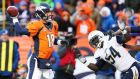 Peyton Manning of the Denver Broncos looks to pass under pressure from Melvin Ingram of the San Diego Chargers in the second quarter during the AFC divisional play-off game in Denver, Colorado. Photograph: Christian Petersen/Getty Images