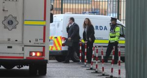 A Garda Van – escorted by detectives – is driven in to a secure area of Blanchardstown District Court. Photograph: Collins