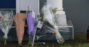 Floral tributes at the house in Castleknock, Dublin where the body of Tom O'Gorman's body was found. Photograph: PA