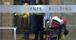 Gardaí at the lift area inside the main entrance in the Hynes Building in Galway city following the death of a three-year-old boy.  Photograph: Joe O'Shaughnessy