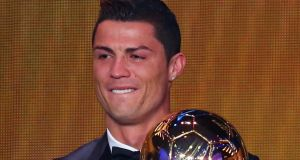 An emotional Cristiano Ronaldo of Portugal receives the FIFA Ballon d'Or 2013 trophy at the Kongresshalle  in Zurich, Switzerland. Photograph: by Martin Rose/Bongarts/Getty Images)