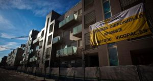 A large banner advertises apartments for sale at the site of newly constructed residential buildings in Madrid. Property prices across Spain dropped by just under 8 per cent last year. Photograph: Angel Navarrete/Bloomberg
