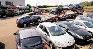 Cars being loaded on to transporter lorries at McCabes garages in Ardee in July last year.