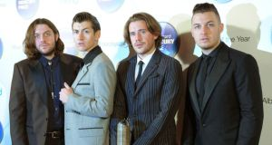 (From left) Nick O'Malley, Alex Turner, Jamie Cook and Matt Helders of Arctic Monkeys who lead the field for this year's NME Awards with eight nominations. Photograph: PA