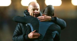 Wigan boss Uwe Rosler  celebrates with Marc-Antoine Fortune  following their team's 3-1 victory after extra time during the  FA Cup third round replay match against Milton Keynes Dons  at Stadium MK. Photograph: Clive Mason/Getty Images