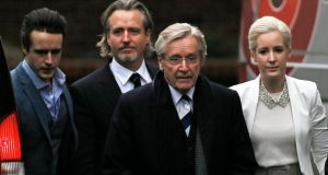 British actor William Roache (second right), who plays the character of Ken Barlow in the soap opera Coronation Street, arrives with his sons James (left) and Linus (second left), and daughter Verity at Preston Crown Court in Preston. Photograph: Phil Noble/Reuters
