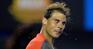 Rafael Nadal feels the heat after defeating Thanasi Kokkinakis of Australia in their second round match. Photograph: Franck Robichon/EPA